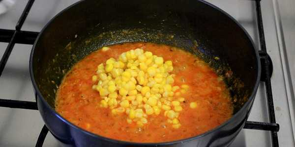 sweet corn masala curry adding boiled corn