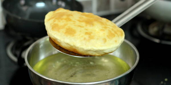Bhature Recipe for Chole Bhature taking out the puri