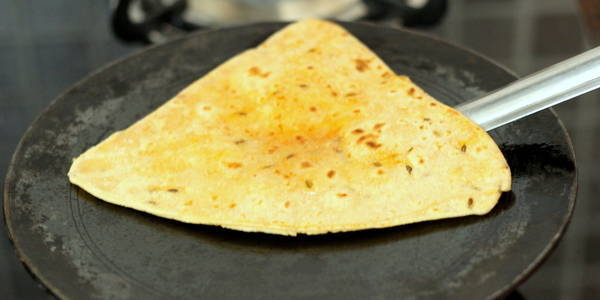 Jeera Paratha Recipe flipping the paratha