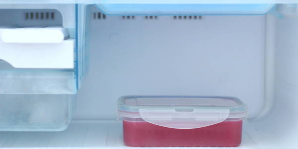 Pomegranate Orange juice placing in fridge