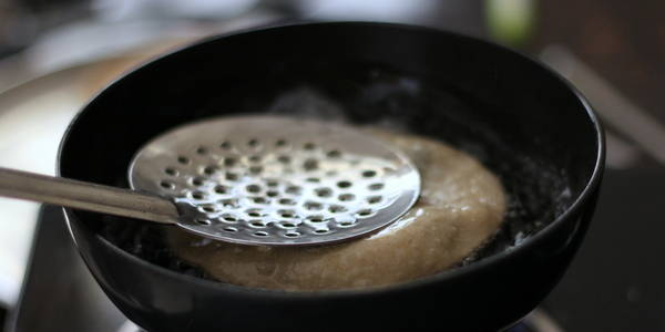 deep frying poori for poori bhaji