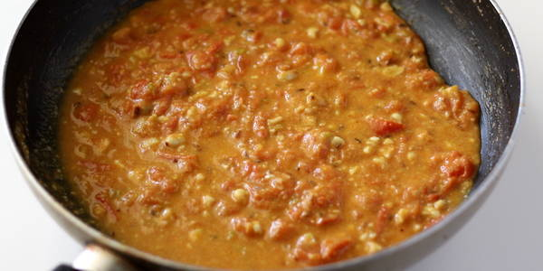 tomato peanut curry cooking